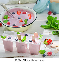 Juicy ice cream with fruits and mint leaf