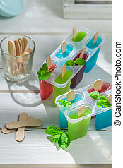 Sweet ice cream with fruits and mint leaf
