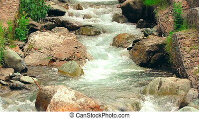 Tropical mountain river flowing through the small village