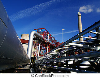 Industrial zone, Steel pipelines and smokestack on blue sky...