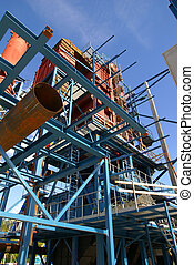 cranes and beams on construction of industrial factory...
