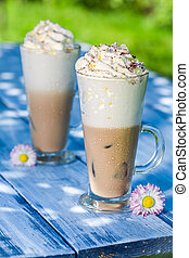 Cold coffee in sunny day