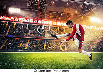 Football action in the stadium - Football player kicks the...