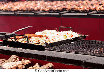 Sausage on the BBQ - Sausage on a barbecue to cook at a fair...