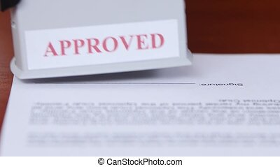 People puts a stamp on the document and endorses of...