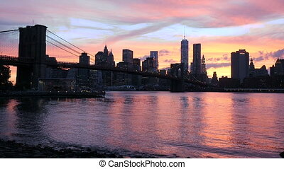 View on the Brooklyn Bridge and Manhattan, sunset - Sunset...