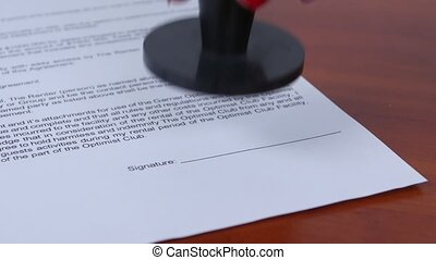 Woman puts a round stamp on the document Close up - People...