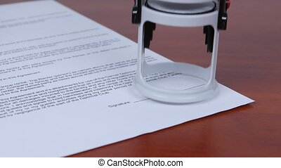 People puts the round seal on the contract. Close up