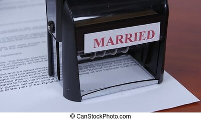 People seals the document of marriage by a rectangular seal. Close up