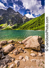Lake in the middle of the mountains at summer