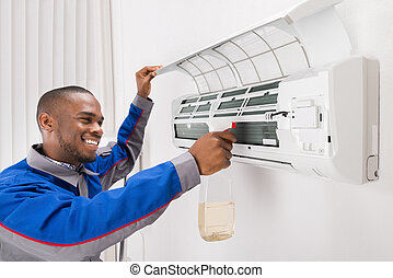 Technician Cleaning Air Conditioner - Smiling Male...