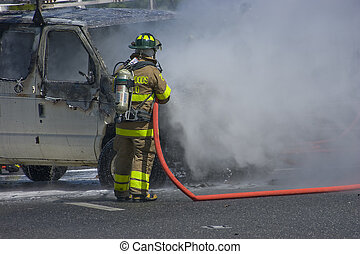 Car Fire - Fireman puts out car fire