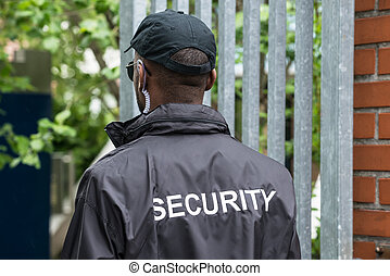 Rear View Of A Security Guard