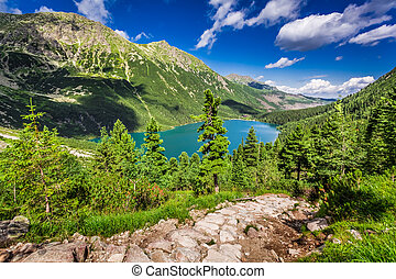 Beautiful lake in the middle of the mountains at summer