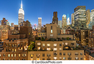 Midtown panorama at twilight from rooftop, New York City.
