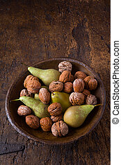 Autumn pears and walnuts in a bowl