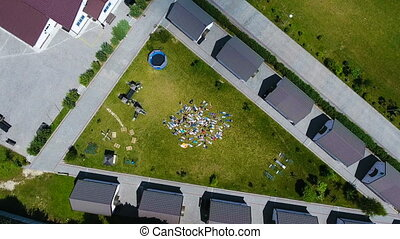 People lie on the grass - people lie on grass, top view