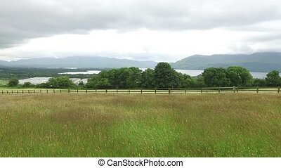 view to lake and farmland at connemara in ireland 52 -...