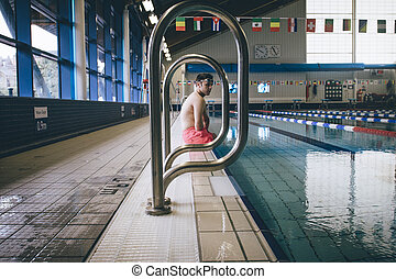 Amputee Professional Swimmer - Quadriplegic swimmer sitting...