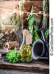Therapeutic tincture in bottles with herbs and alcohol
