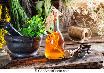 Aromatic tincture with herbs and alcohol