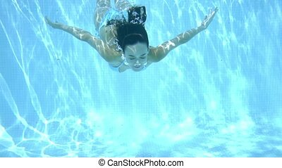 Happy young woman smiling underwater