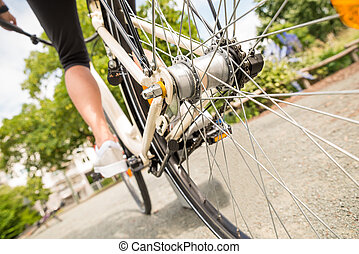 Close-up Of A Woman's Leg Peddling Bicycle - Close-up Of A...