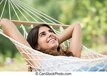 Happy Woman Relaxing In Hammock - Close-up Of A Young Happy...