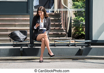 Happy Businesswoman Using Cellphone