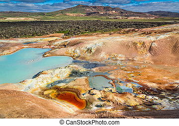 Colorful ground full of minerals on volcanic mountain,...
