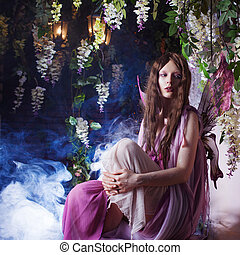 Young beautiful woman in the image of fairies, magic dark...