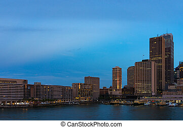 Circular Quay cityscape in the evening. Sydney, Australia -...