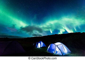 Camp with Northern lights in Iceland