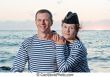 man with a woman standing on the background of the sea