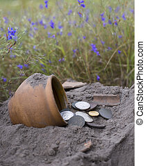 The hoard of gold coins - Pot of gold coins collected with...