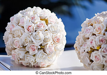 flowers arrangement on bridal car - White roses arrangement...