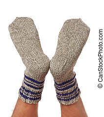 Warm knitted socks - Legs of caucasian man in knitted warm...