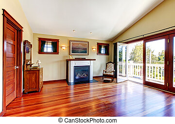Room with beautiful cherry hardwood floor and fireplace