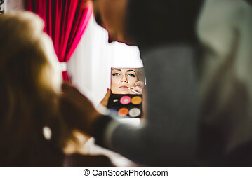 Surrealistic portrait of young lady which make makeup with...