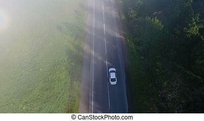 aerial shot of car on the road