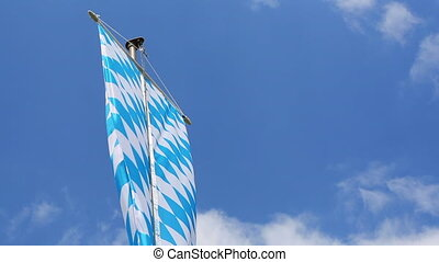 Bavarian flag in front of blue sky and white clouds
