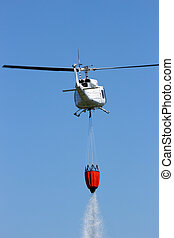 Helicopter fire fighting - Helicopter with a Bambi bucket...