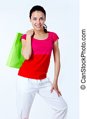 Happy shopper - Happy female with bright green bag looking...