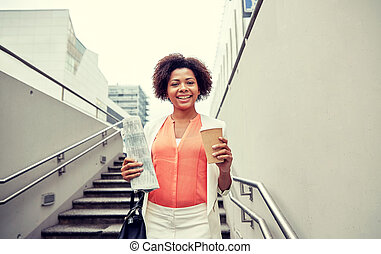 happy african businesswoman with coffee in city - business...