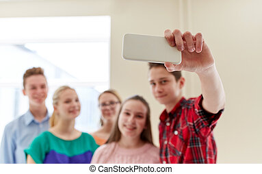 group of students taking selfie with smartphone - education,...