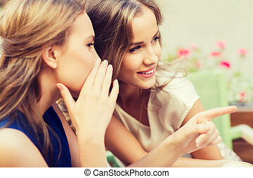 smiling young women gossiping at outdoor cafe - people,...