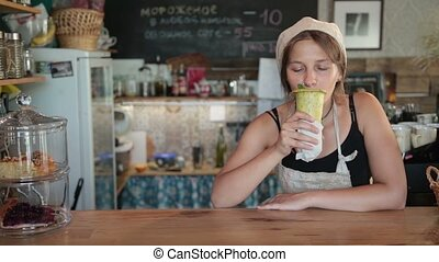 Young beautiful woman cook enjoying the meal - Young...