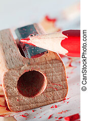 Pencil and Sharpener - Red pencil and sharpener close-up....