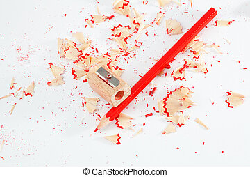 Pencil and Sharpener - Red pencil and sharpener on white...