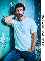 jeans italian style - Portrait of a handsome young man in...